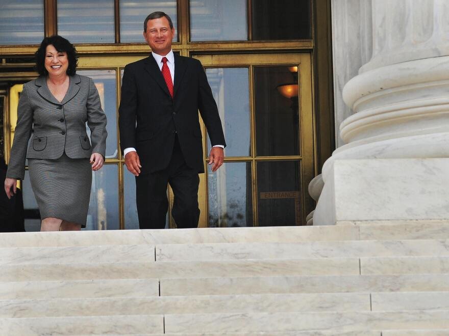 Chief Justice John Roberts and Associate Justice Sonia Sotomayor exit the front entrance of the Supreme Court building following Sotomayor's investiture ceremony in 2009.