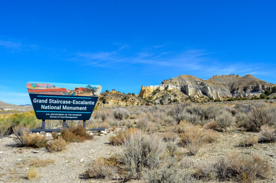 A photo of a sign showing the Grand Staircase-Escalante National Monument.