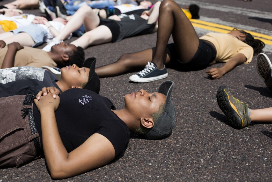 Students take part in a die-in to remember people killed by St. Louis police last year.