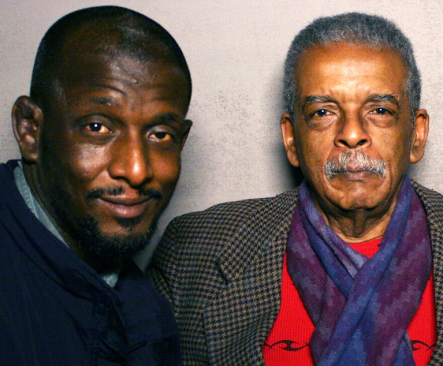 Lawrence (right) recounted his 1963 walk from New York to Washington, D.C., to his son, Simeon, on a visit to StoryCorps.