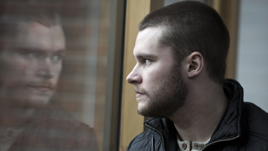 John (Jack Reynor) must work for a petty criminal to pay for his mother's rehab program in the new film <em>Glassland.</em>