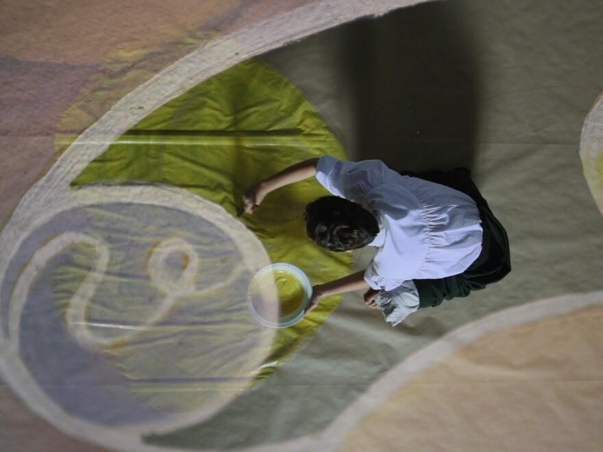 Hilma af Klint paints in the streaming-on-demand documentary <em>Beyond the Visible: Hilma af Klint.</em>