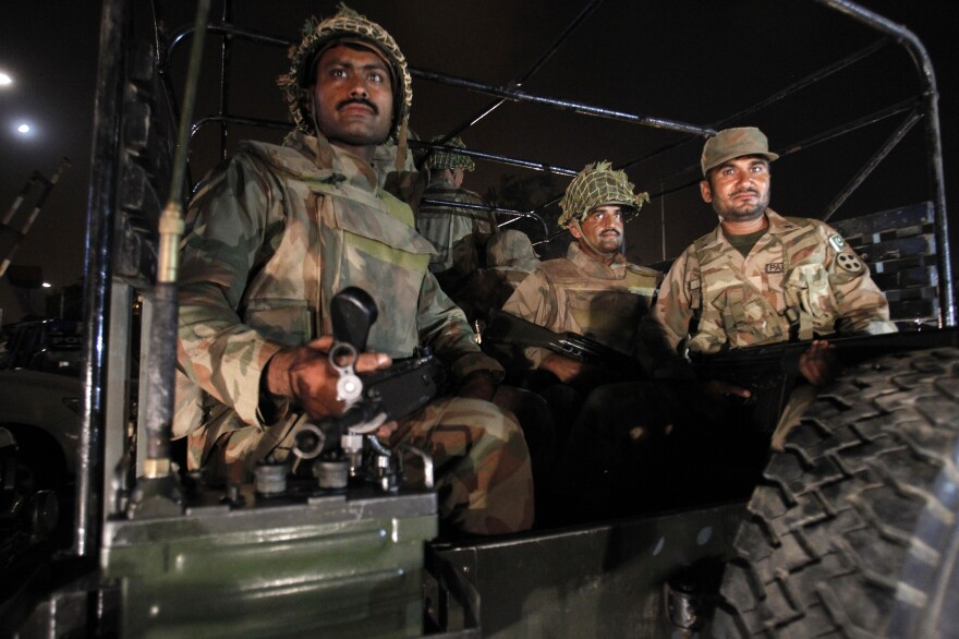 Pakistan army troops arrive at Karachi airport following an attack on June 8 by the Pakistani Taliban. More than 30 people were killed, and the military has now launched an offensive against the Taliban.