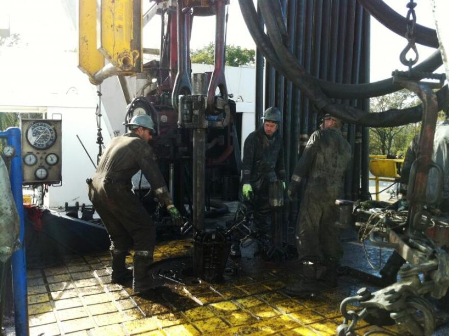Drilling crew working a rig in Carroll County, 2011