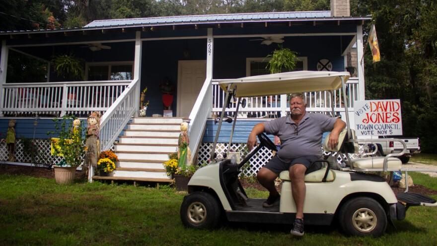 Samuel David Jones sits on a golf cart