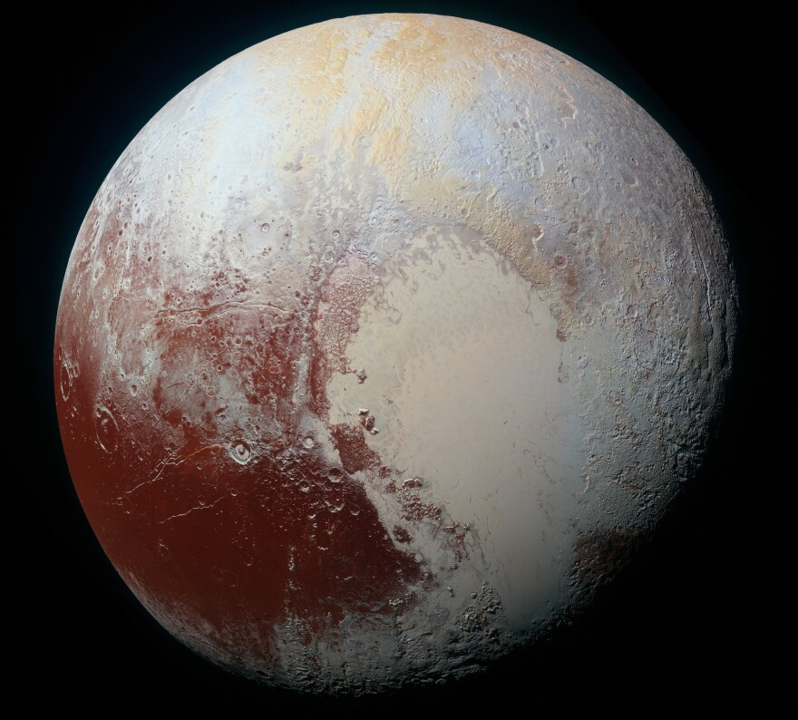 "A high-resolution ""false color"" view of Pluto shows the dwarf planet's surface composition. New analysis shows that some of the bright red areas also include frozen water."