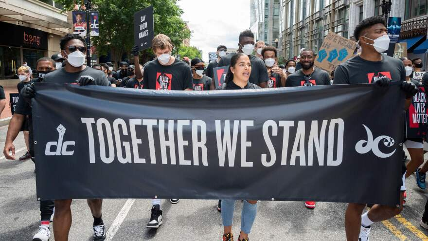Demonstrators take part in a Juneteenth march and rally Friday in Washington, D.C., one of a number of major cities to see large gatherings commemorating the date.