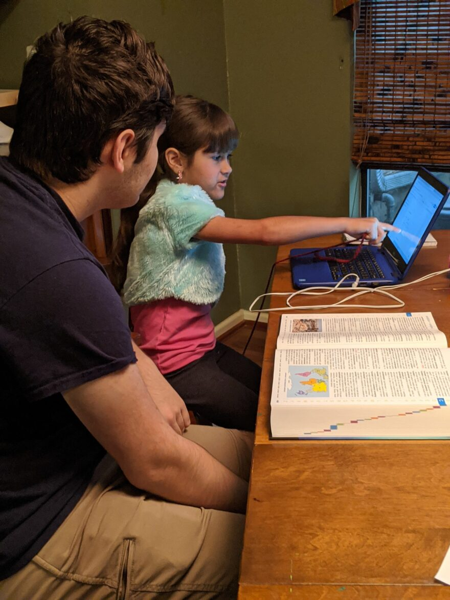 Erin Rodriguez says her older children help the youngest with schoolwork.