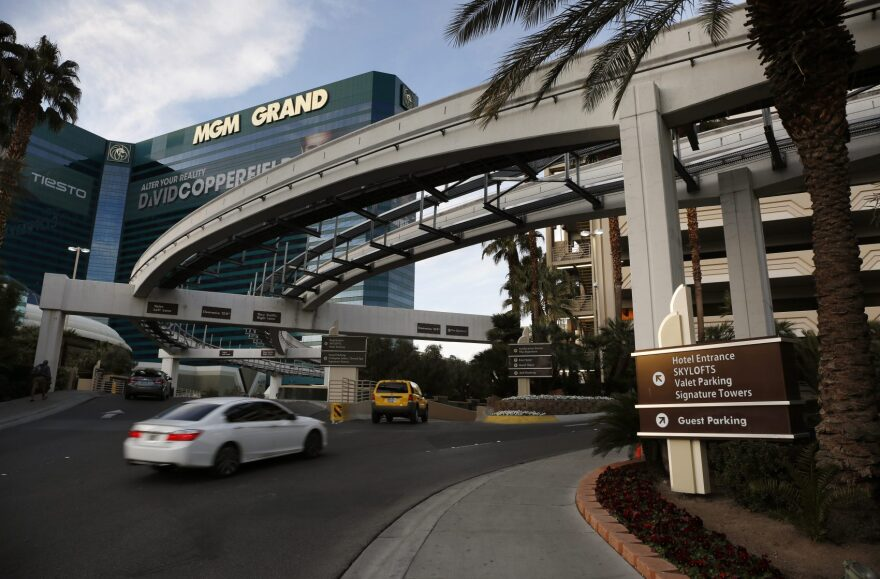 Cars drive into the MGM Grand hotel and casino in Las Vegas in January 2016. MGM International began charging for parking at its resorts in the city in June. (John Locher/AP)