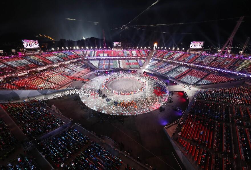At the closing ceremonies, Olympic athletes enter the stadium.