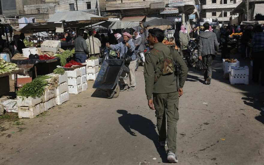 A member of the Kurdish security forces patrols a popular market in Manbij, Syria, last April. The city had been mostly calm since the Kurds and the U.S. drove the Islamic State out of the city in 2016.