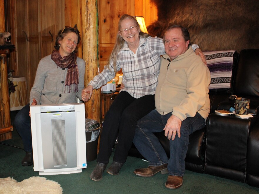 When wildfire smoke choked their community last summer, Amy Cilimburg (left), the director of Climate Smart Missoula, helped Joy and Don Dunagan, of Seeley Lake, Mont., get a HEPA air filter through a partnership with the Missoula City-County Health Department.