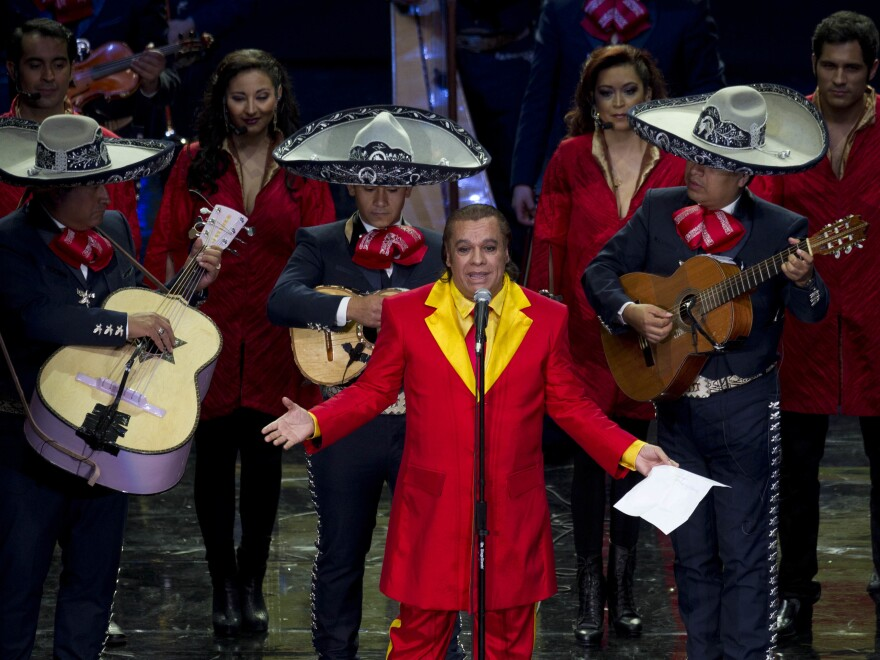 Juan Gabriel performs during an event honoring Mexican comedian Roberto Gomez Bolanos in Mexico City.