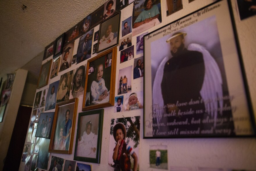 Photos of the Williams family on a wall