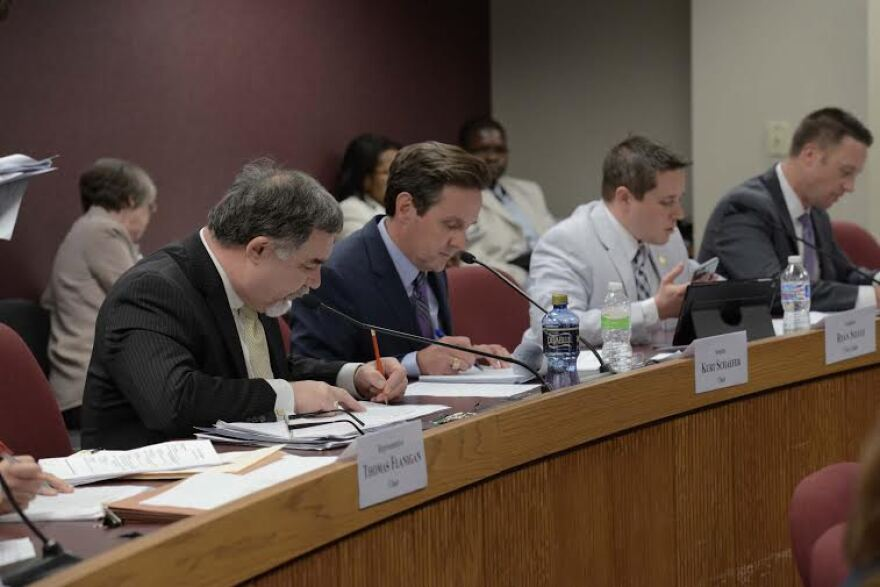 Members of the House and Senate budget committees hash out their differences earlier this year. While the budgetary process in Missouri isn't always pretty, it's a picnic compared to what's going in Kansas and Illinois.