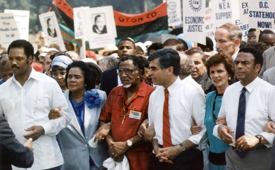 Joseph Lowery, center, marches with Coretta Scott King, Rev. Jesse Jackson, Michael Dukakis, his wife Kitty and Mayor Andrew Young of Atlanta in 1988 during the 25th anniversary of Dr. King's march on Washington, DC.