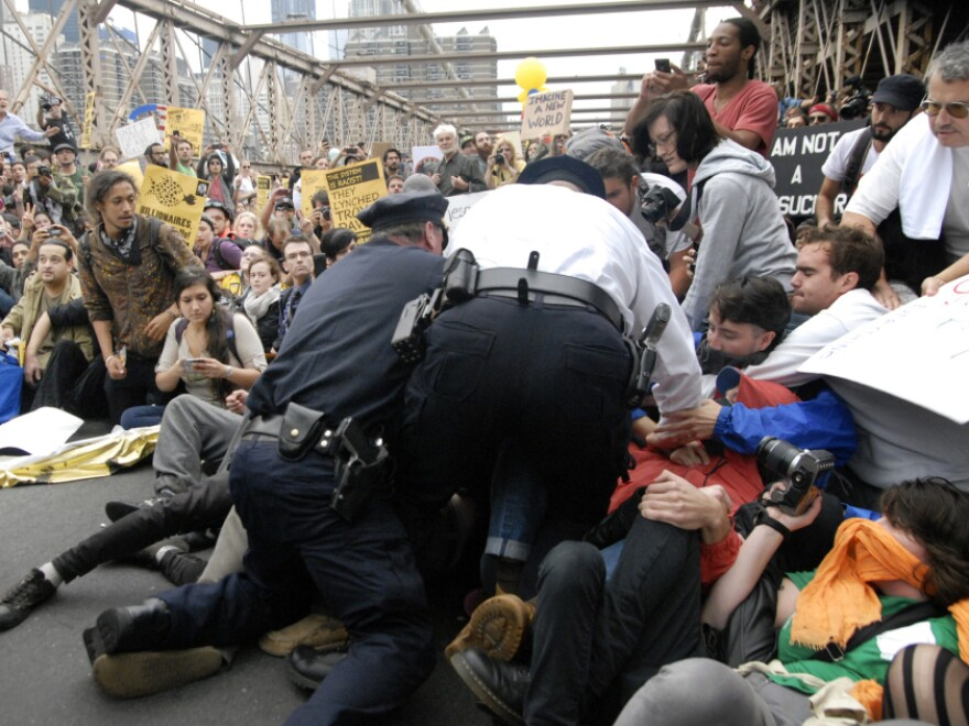 "<p>Police begin to arrest ""Occupy Wall Street"" demonstrators on the Brooklyn Bridge. Saturday, Oct. 1, 2011.</p>"
