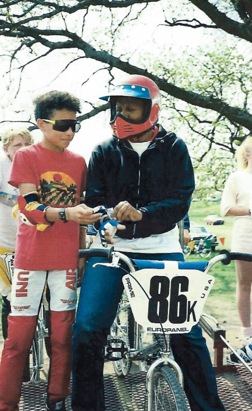 In a photo from 1988, Max Knauer gives his mother, Kittie Weston-Knauer, a hand as she prepares to start her first BMX race.