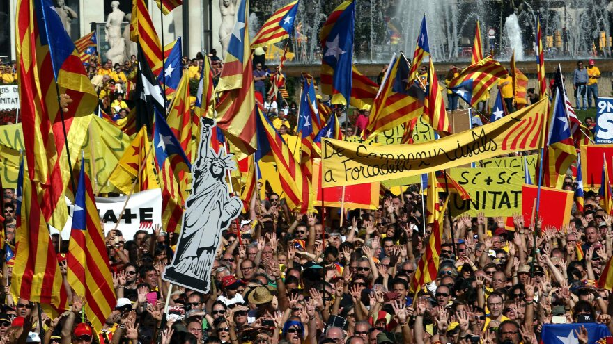 People rally in support of a referendum on independence at the Catalonia Square in Barcelona, Spain, on Oct. 19. A nonbinding referendum is set for this Sunday.