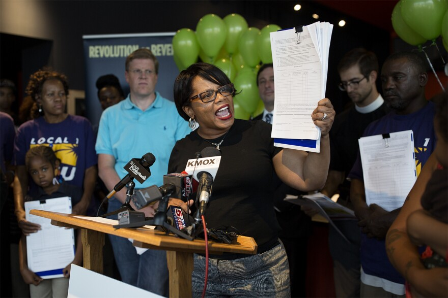 State Sen. Jamilah Nasheed holds up a petition at a rally at Urban Chestnut Brewing Company on Monday. Raise Up Missouri is gathering signatures to put a statewide $12 an hour initiative on the ballot. Aug. 28, 2017