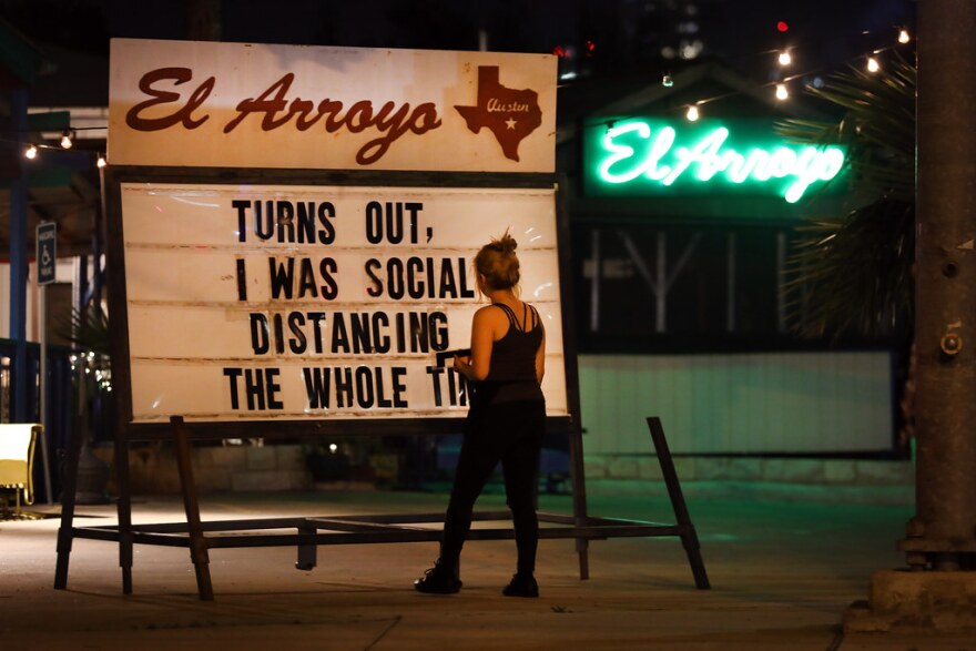 Calls to social distance during the pandemic can be seen on city street signs, buses and at El Arroyo.