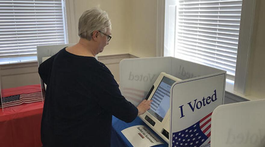 Lancaster resident Rita Huffman test drives the county's new voting machines at a recent public demonstration. The new system is a two-step process that involves a return to a handheld paper ballot.