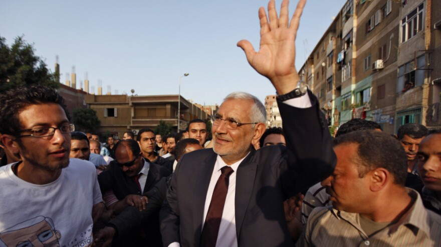 Egyptian presidential candidate Abdel Moneim Aboul Fotouh is welcomed by supporters upon his arrival at a meeting north of Cairo, on April 26. He was formerly a leader of the Muslim Brotherhood, but was kicked out of the organization.