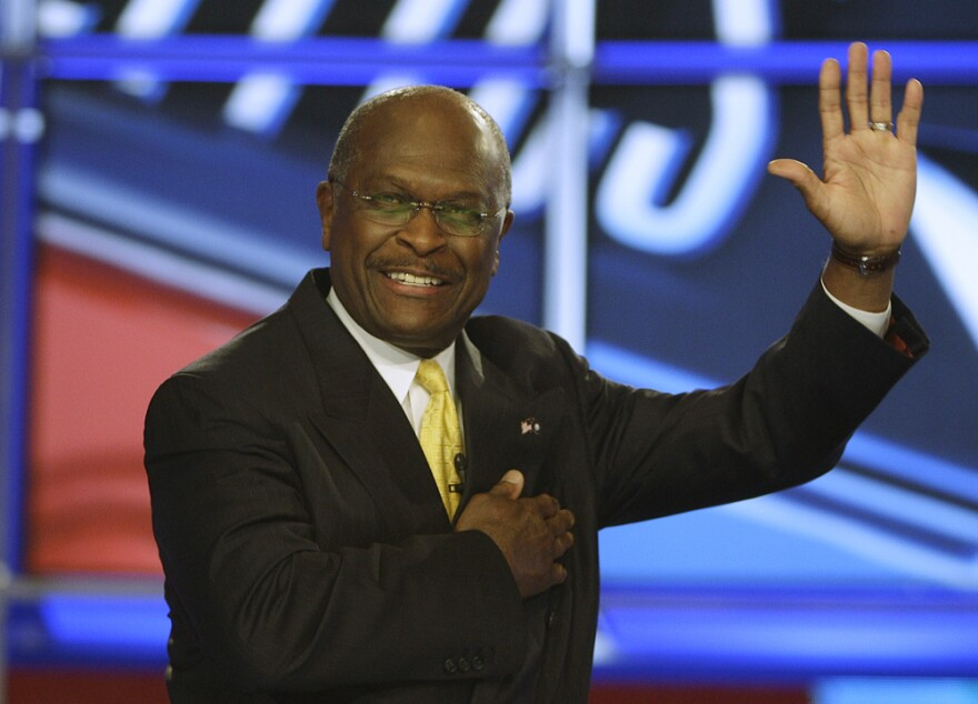 <p>Herman Cain waves before a GOP debate at St. Anselm College in Manchester, N.H., in June. Pollster Andy Smith says most New Hampshire residents prefer having no broad-based income tax or sales tax. </p>