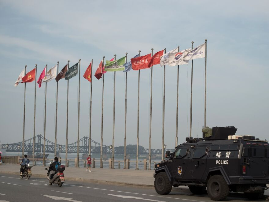An armored Chinese police van is seen next to the Friendship Bridge on the Yalu River connecting the North Korean town of Sinuiju and the Chinese city of Dandong. China is North Korea's biggest trading partner.