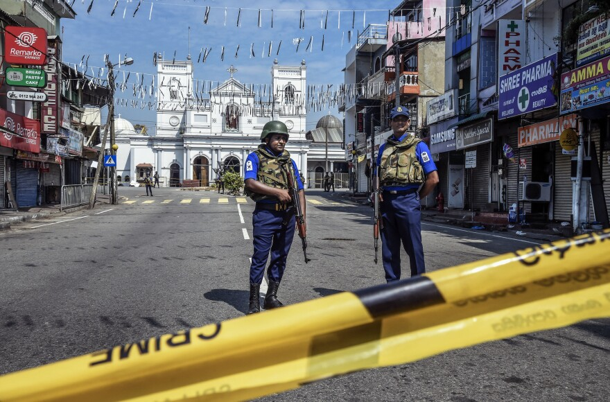 Security personnel stand guard at St. Anthony's Church on April 24 in Colombo, Sri Lanka. The church was among three targeted in this year's Easter Sunday attacks.