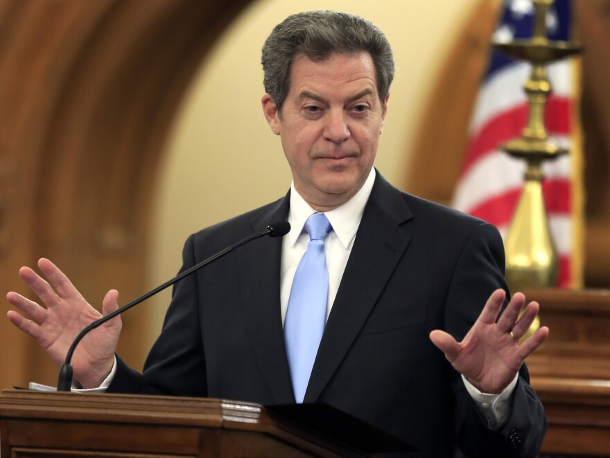Kansas Gov. Sam Brownback speaks to the state Legislature in Topeka. The state Supreme Court rejected some education funding changes enacted by lawmakers earlier this year and threatened to order the state's public schools closed if inequality is not corrected.