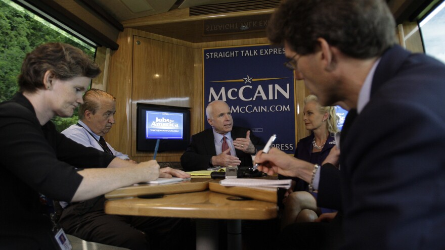 "McCain meets with reporters on his campaign bus, ""Straight Talk Express,"" in 2008. McCain may have been one of the last presidential candidates to give reporters regular, unfettered access."