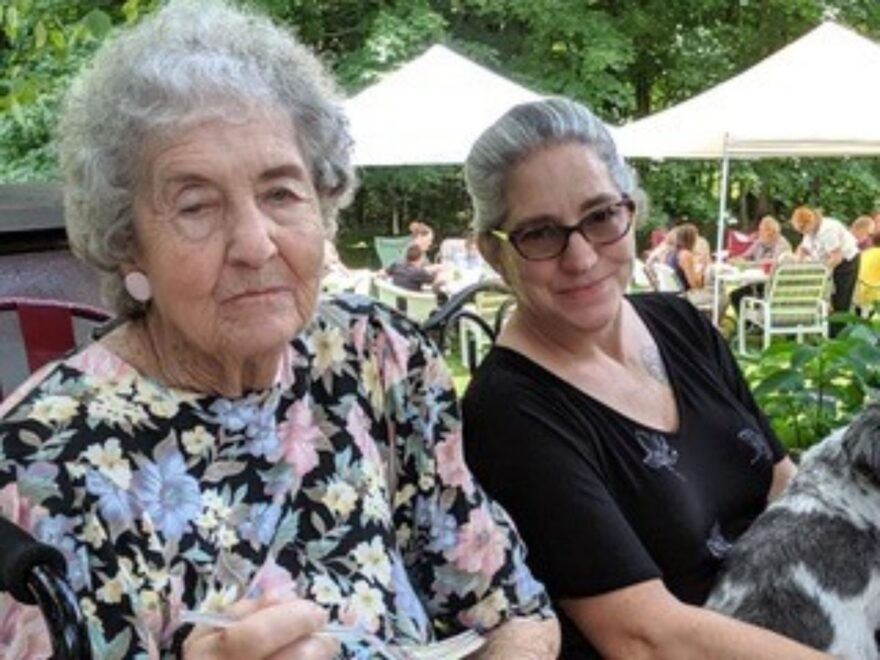 "Julie Burkey (right) sits with her aunt known as ""Jean"" (left) who died in April. Burkey suspects her elderly aunt died from coronavirus, though that hasn't been confirmed."