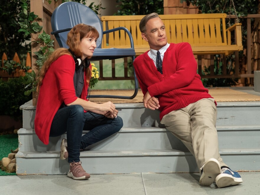 """The way the public feels about Tom Hanks has a similar quality to how we feel about Mister Rogers,"" says director Marielle Heller. But she found that Hanks and Rogers had a very different energy. At the beginning, she tried to ""rein Tom's natural buoyancy back and settle him into a kind of zenlike state.""<em></em>"