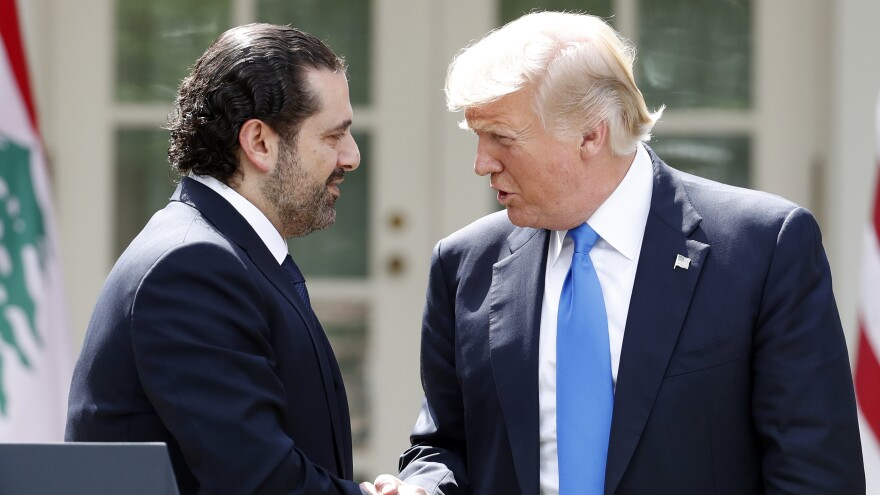 President Donald Trump shakes hands with Lebanese Prime Minister Saad Hariri during a joint news conference in the Rose Garden Tuesday.