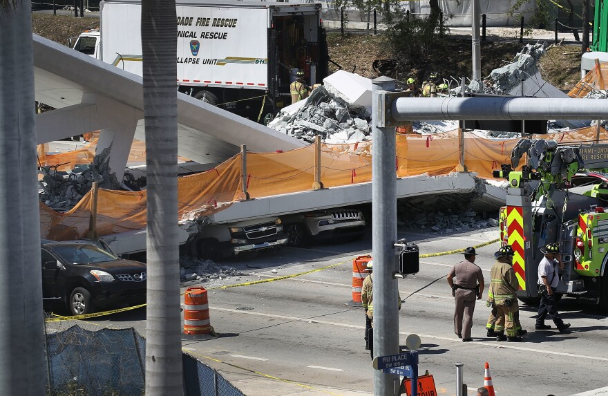 A pedestrian bridge under construction near Florida International University in Miami collapsed Thursday, trapping people and vehicles underneath.