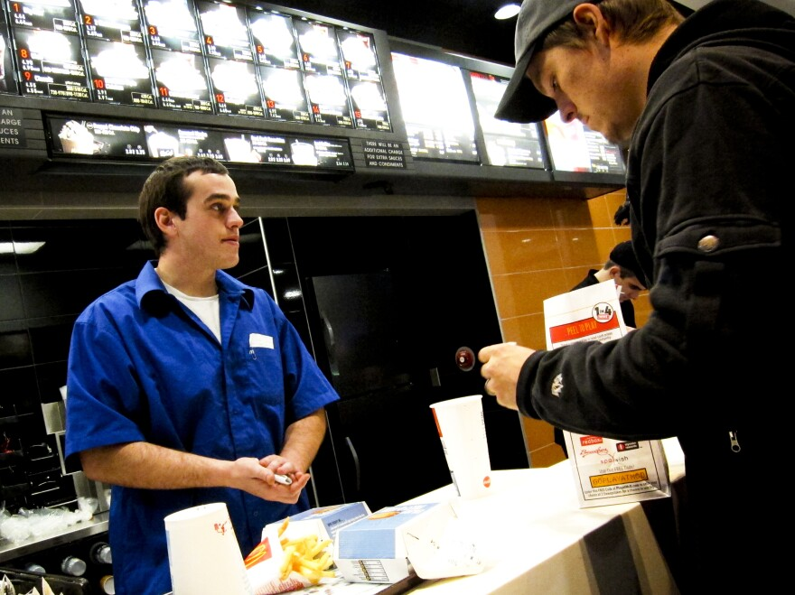 """Kyle Pfifer works at a McDonald's in Williston, a job he got the same day he applied. He says he turned in his application, got lunch, """"and I had a call before I was done eating, and I had a job."""""""