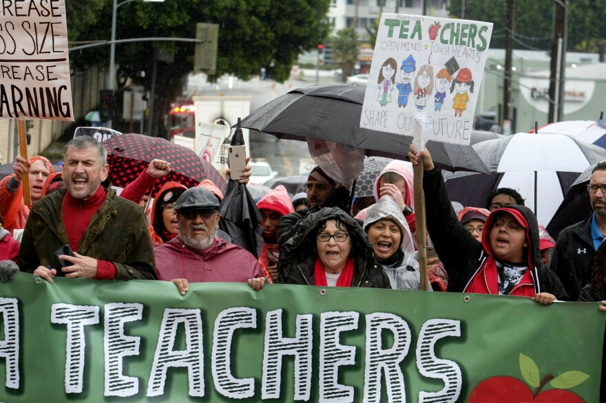 Thousands of teachers and supporters hold signs in the rain during a rally Monday, Jan. 14, 2019, in Los Angeles. (Ringo H.W. Chiu/AP)