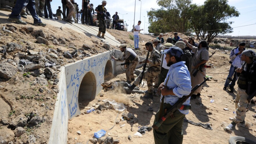 <p>AFP/Getty Images says this photo was taken at the site where Libyan National Transitional Council (NTC) fighters say Moammar Gadhafi was surrounded earlier today.</p>