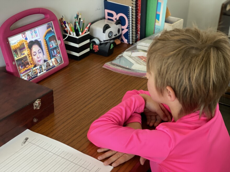Photo of a child in an online video conference.