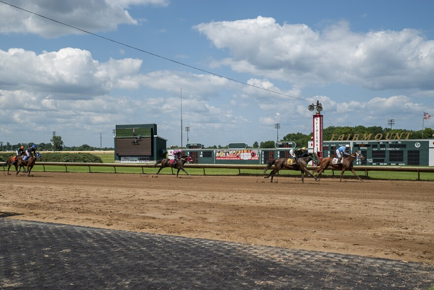 Horses cross the finish line at Fairmount Park Racetrack on July 23. The number of live races at the track will likely increase to 100 because of the gambling expansion bill passed earlier this year.