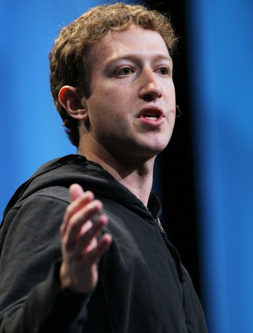 Facebook founder and CEO Mark Zuckerberg, in black hoodie.