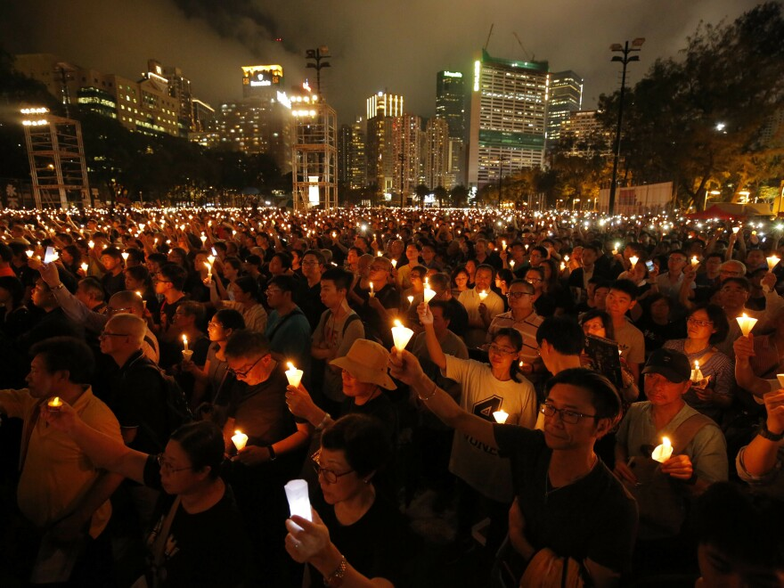 Thousands attend a 2019 candlelight vigil in Hong Kong for victims of the Chinese government's 1989 crackdown on protesters in Beijing's Tiananmen Square. Organizers question why police are blocking the demonstration this year.