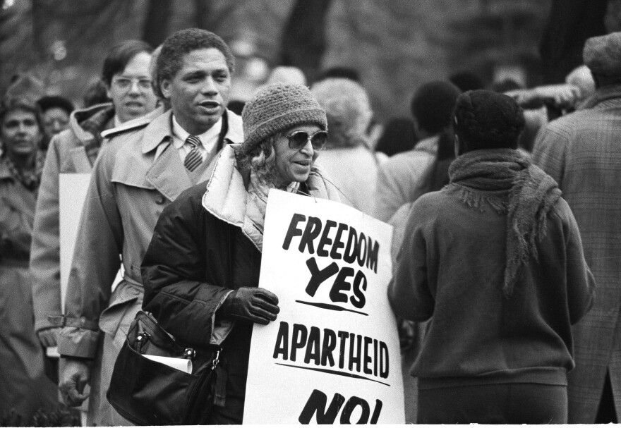 Rosa Parks joins in a march at the South African Embassy in Washington, Dec. 10, 1984, protesting that country's racial policies. She's famous for refusing to give up her seat on a bus in 1955, sparking the Montgomery boycotts — but her activism spanned her entire life.