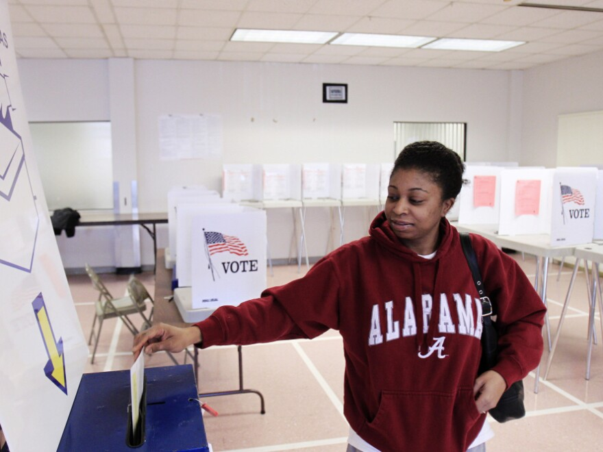 As the candidates head into Super Tuesday on March 6, Ohio is shaping up as the biggest prize. Sheenae Westmoreland drops her ballot into the box after early voting in Cleveland on Jan. 31. Early in-person voting is set to continue until March 2.