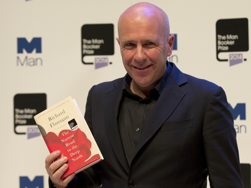 Australian author Richard Flanagan, 2014's Man Booker Prize winner, holds his book <em>The Narrow Road to the Deep North</em> at the Royal Festival Hall in London on Monday.