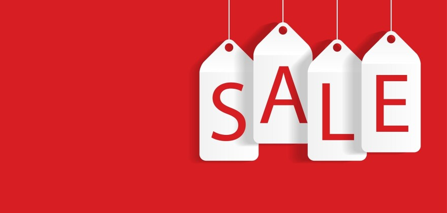 "Red background withe word ""sale"" spelled out on it on white sales tags"