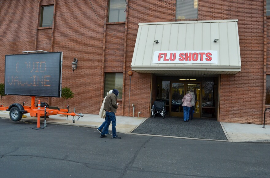 A photo of people going into the Southwest Utah Public Health Department office in St. George.