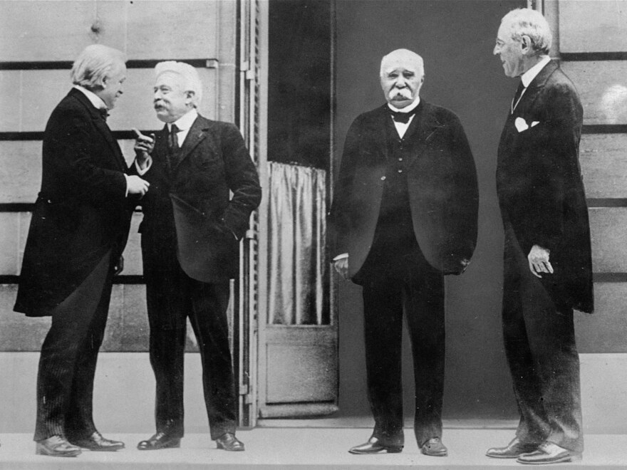 The Big Four of the Allies chat while gathering at the Palace of Versailles in 1919 for the Treaty of Versailles, which officially ended World War I. They are (from left) David Lloyd George of Great Britain, Vittorio Orlando of Italy, Georges Clemenceau of France, and Woodrow Wilson of the United States.