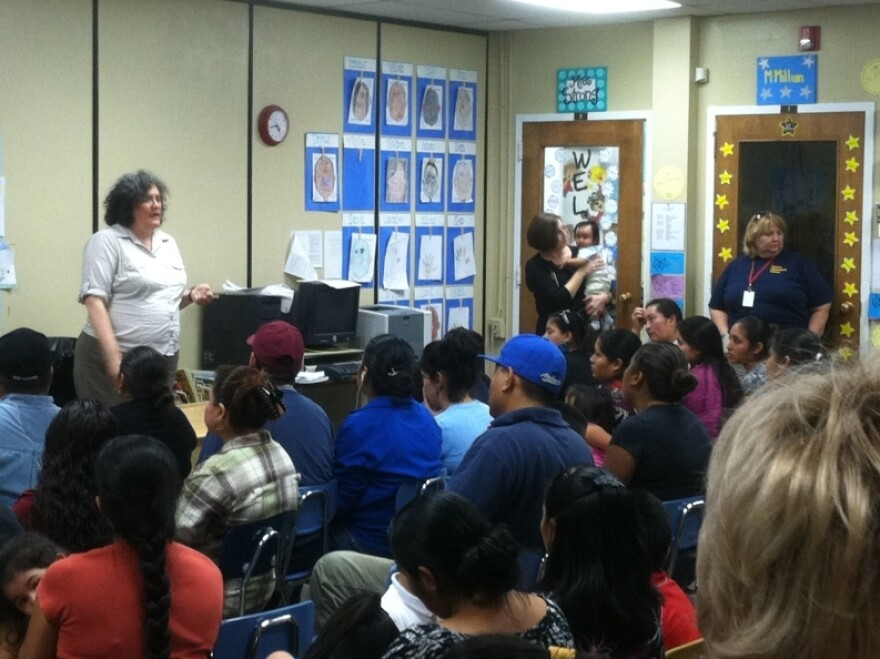 <p>Monica Hernandez of the Southeast Immigration Rights Network addresses a Know Your Rights meeting at Tarrant Elementary School, just north of Birmingham, Ala.</p>